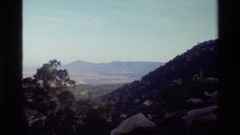 1983: a large mountain looms over a deep and vast valley MARA TANZANIA Stock Footage