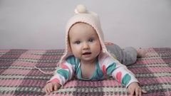 Cute baby girl in a pink hat Stock Footage