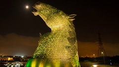 The Kelpies sculpture and full moon at night. Stock Footage