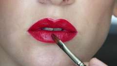 Closeup video of beautiful girl's lips make up Stock Footage
