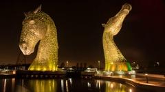 Kelpies sculpture lit up at night Stock Footage