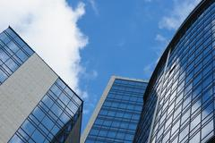 Multistory glass office building on a background of the sky Stock Photos
