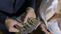 Beautiful young slim girl counts the money transferred to her man Stock Footage