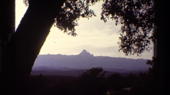 1983: distant mountain viewed from shaded area KENYA Stock Footage