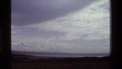 1983: darkened sky with lake and hills beyond KENYA Stock Footage