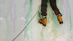 Ice Climber, Young man with ice axes and crampons training to climb  Stock Footage