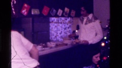 1975: teenage brothers and sisters take their plates to the meal table at Stock Footage