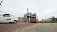 Timelapse London red bus over London bridge with pedestrians walking nearby Stock Footage