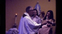 1975: father is giving away candles to a man and a woman in a church CALIFORNIA Stock Footage