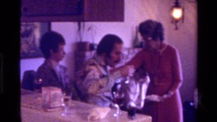 1975: a family get-together in the living room with drinks being served Stock Footage