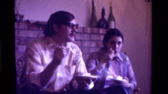 1975: boy and girl enjoying plates of home cooked food served by mom CALIFORNIA Stock Footage