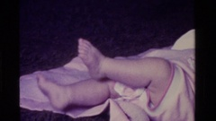 1975: an infant's legs and feet kicking CALIFORNIA Stock Footage