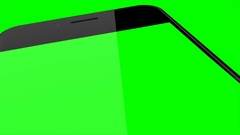 Smartphone turns on on Green background. Easy customizable green screen Stock Footage
