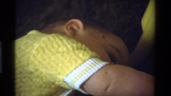 1975: a wee little baby crawling around on a bed CALIFORNIA Stock Footage