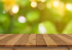 Wood floor and bokeh background Stock Photos
