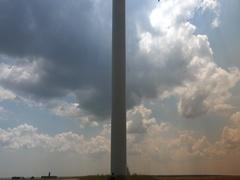 Wind power generator on golden wheat field Eco power concept.Tilt up 4k UHD Stock Footage