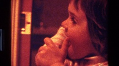 1977: a kid licking her arm CALIFORNIA Stock Footage