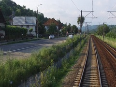 Point of view train passing through countryside hypnotic moving railroad tracks Stock Footage