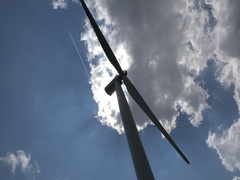 Wind power generator  dramatic skyairplane traces speed motion 4k UHD Stock Footage