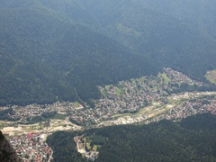 Aerial view of Busteni  town Romania near to Heroes Cross  zoom out 4k UHD Stock Footage