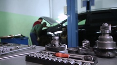 Tools and auto parts in the background of the service Stock Footage