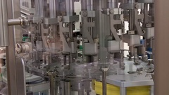 Pharmaceutical factory filling syringes with vaccine Stock Footage