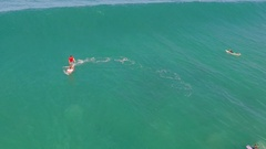 Aerial view of a man sup stand-up paddleboard surfing in Hawaii. Stock Footage