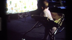 1977: a baby moving around in a bouncer CALIFORNIA Stock Footage