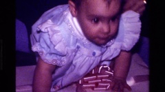 1977: a baby plays with his mom in an environment full of gifts CALIFORNIA Stock Footage