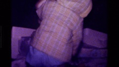 1977: toddler moves large teddy bear CALIFORNIA Stock Footage