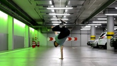 Young man dancing breakdance in the garage. Stock Footage