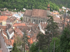 UHD 4K Aerial view of Brasov and Black Church medieval city in sunny day Stock Footage