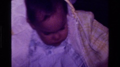1977: cute baby wearing a jacket enjoying playtime CALIFORNIA Stock Footage