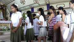 Young girls receive sacrament of communion Stock Footage