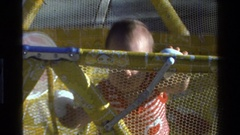 1977: baby standing up in a playpen CALIFORNIA Stock Footage