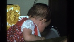 1977: cranky baby at dinner table CALIFORNIA Stock Footage