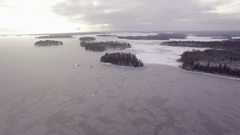Newly frozen lake with islands in Finland. Aerial shot Stock Footage