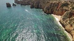 Aerial. Cape Lighthouse Ponta da Piedade shot in the air video. Algarve Lagos. Stock Footage