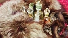 Perfume in the silver fox fur Stock Footage