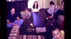 1977: a family gathered in the living room CALIFORNIA Stock Footage