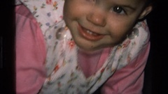 1977: a baby stuffing her head in a pillow CALIFORNIA Stock Footage