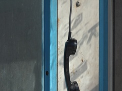 Vandalized rusty payphone booth Hanging handset 4k UHD.Tilt up . Stock Footage