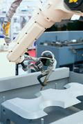 Industrial welding robot arm Stock Photos