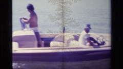 1977: enjoying in the water by surfing with friends in a boat joyfully LAKE Stock Footage