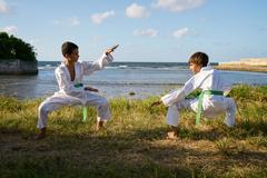 Kids Training At Karate School For Sport Activity Leisure Fun Stock Photos