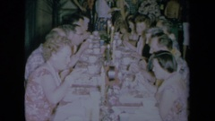 1961: a large number of people eating at the dinner table CALIFORNIA Stock Footage