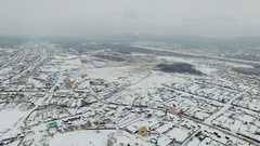 Aerial view of small town at winter Stock Footage