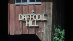 1969: a white sign on a wooden building reads daffodil hill CALIFORNIA Stock Footage