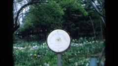 1969: a round white sign for mclaughlins private & garden CALIFORNIA Stock Footage