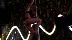 Young woman practicing, performing pole dance Stock Footage